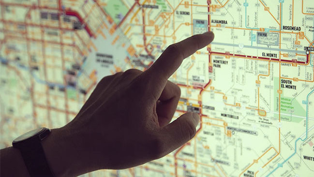 Person pointing to a map planning their healthcare career.